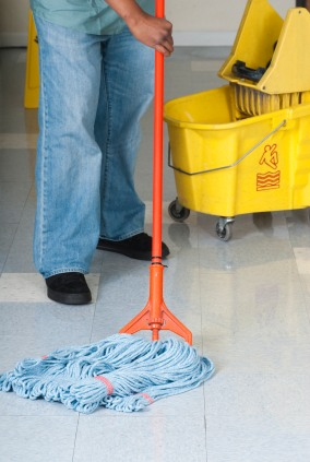Cleanrite Commercial Cleaning Inc janitor in Colts Neck NJ mopping floor.